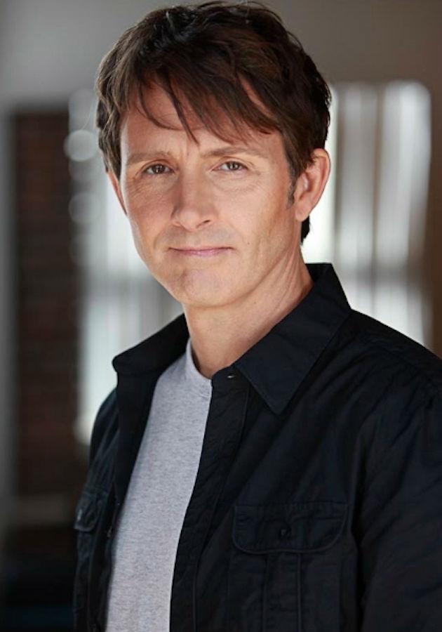 actor-jean shirt-standing-serious